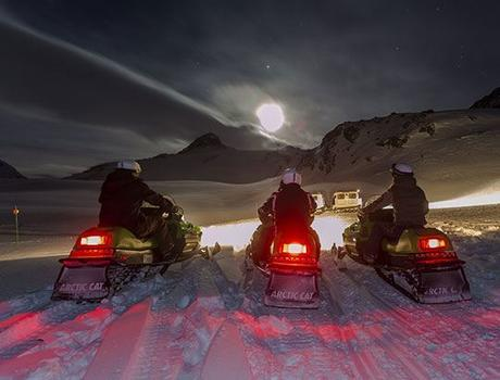 Snow bikes by night